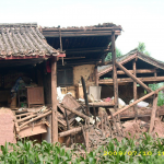 Collapsed adobe-wood building in epicenter area.