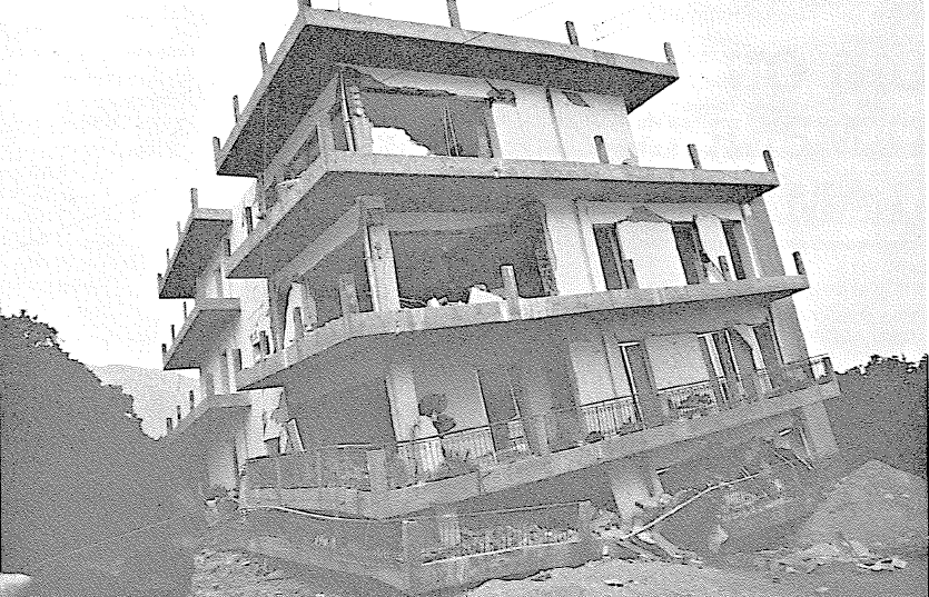 Partial Collapse Of A Five Story Reinforced Concrete Apartment Building.  The Partitions Are Brick Walls. The Building Was Brand New.