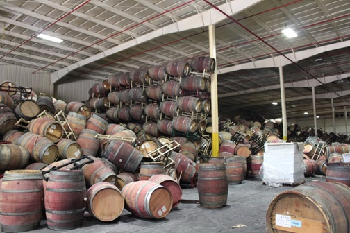 Collapsed barrel stacks leaning on interior column after Napa earthquake